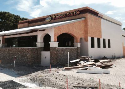 Commercial Painting. Complete Faux finish of exterior walls at Tijuana Taxi in Deerfield Beach FL