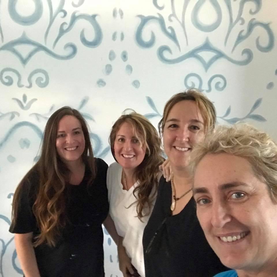 4 women team creating hand painted custom pattern instead of wallpaper