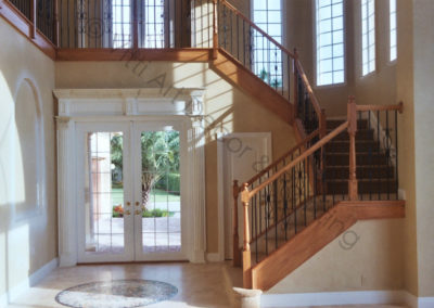 Staircase faux wood grained by Vitti Art Decor of South Florida