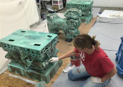 2 large Foo Dog statues being Re-Finished to Patina