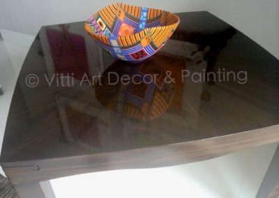 hand painted faux wood grain pattern on a dining room table