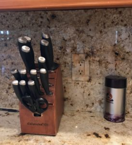 faux receptacle outlet switches to blend with backsplash.