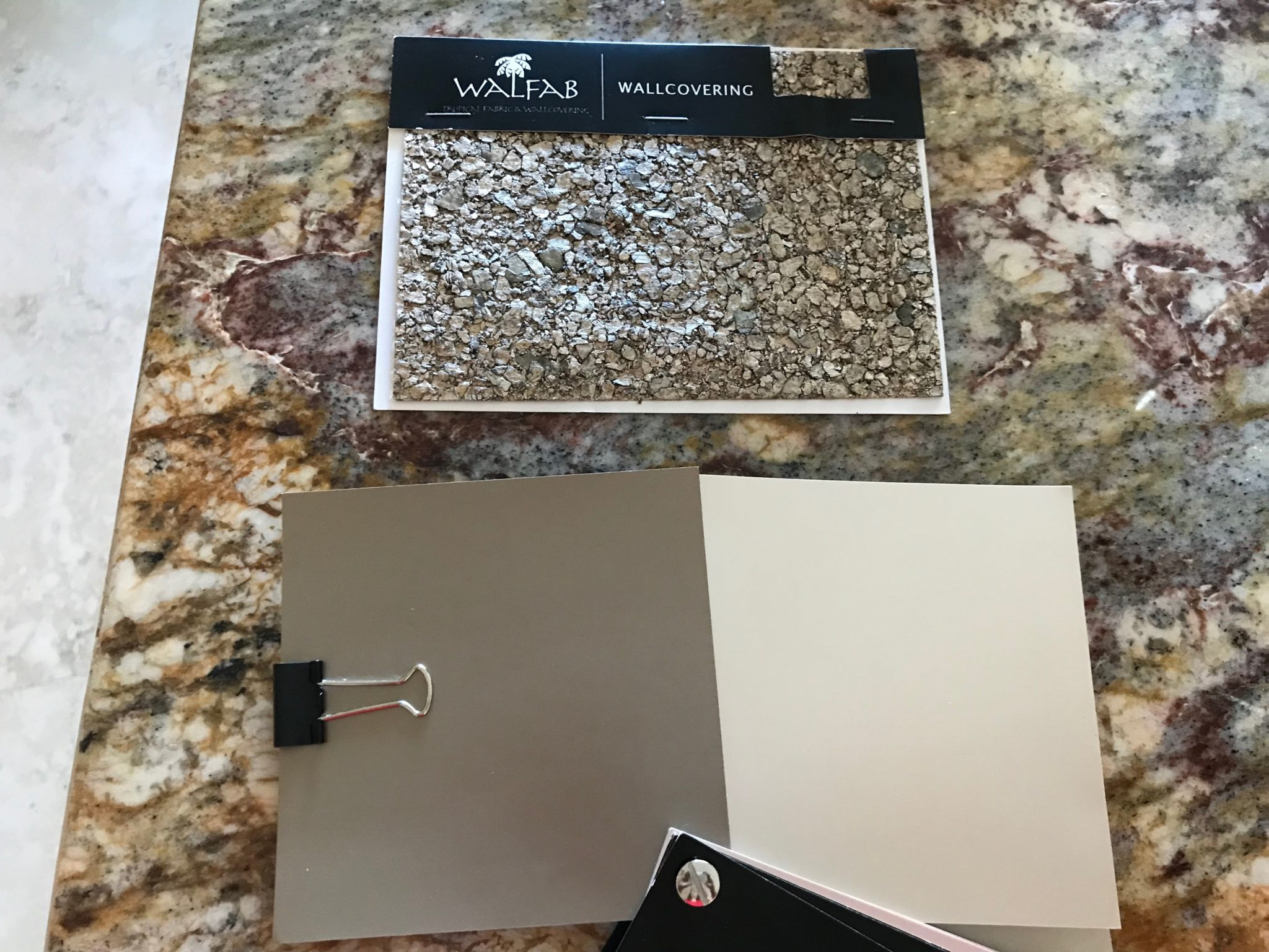 Matching paint colors to a wallpaper sample.