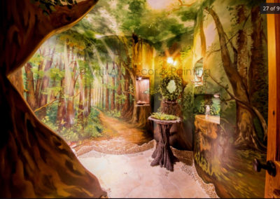 Forest Themed Mural in bathroom by Mabel Vittini.