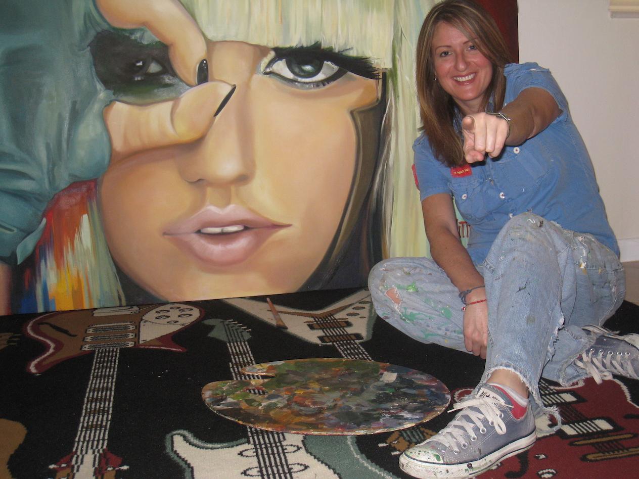Mabel Vittini of VittiArt Decor with her original painting of GA GA